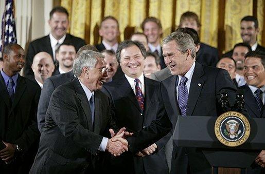 PresidentGeorge W. Bushshakes hands with Marlins' skipper Jack McKeon