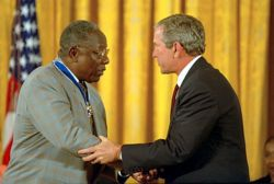 Hank Aaron receives the Presidential Medal of Freedom from President George W. Bush at the White House on July 9, 2002.