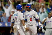 Ramirez (right, wearing number 2) speaks with Jose Reyes during the 2009 WBC during a game against Holland.