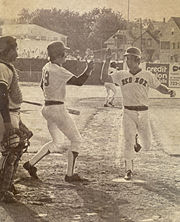 Wade Boggs greets Barrett at home after Barrett scores the winning run in the longest minor league game ever