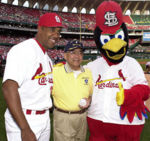 Eduardo Perez, left, shown with the Sect. of Transportation and the Cardinals Mascot in 2002